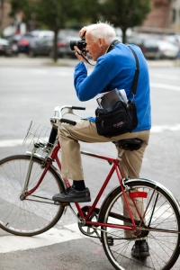 Bill Cunningham, famous for taking photos while on his bicycle.