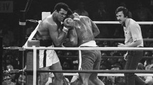 Muhammad Ali and Smoking Joe Frazier fight in the Thrilla in Manila